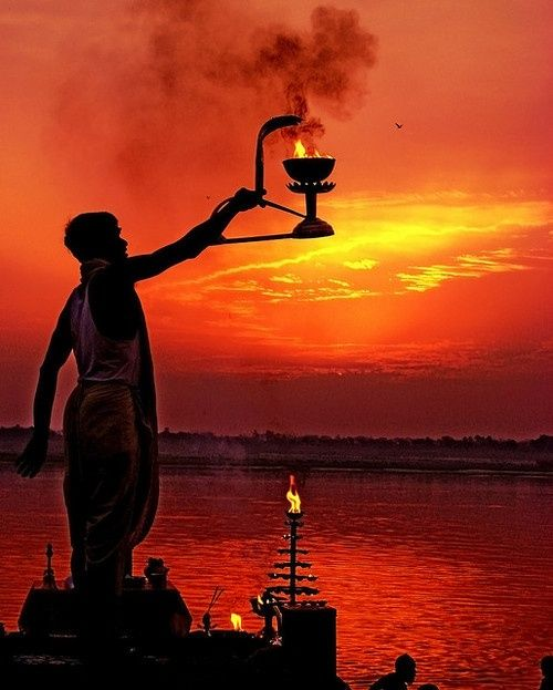 Sunset at the Ganga river, India. Hindu prayers