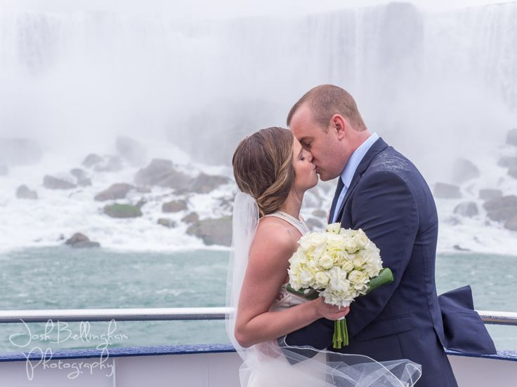 Romantic Niagara Falls Elopement. The bride and groom kissing at Niagara Falls Waterfalls. Niagara Wedding Photographer and Hornblower Niagara Cruises. @niagaracruises #JoshBellinghamPhotography
