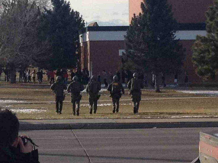 tudents were escorted out Arapahoe High School in Centennial, Colo. with their hands up after a shooting broke out on Friday, Dec. 13, 2013.