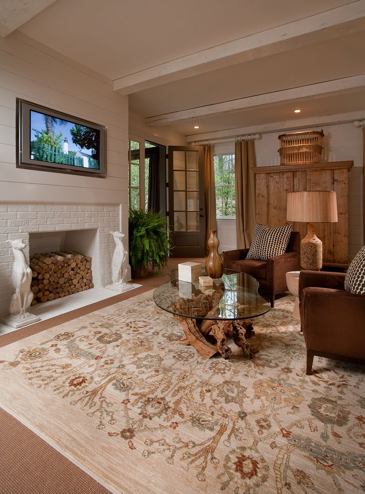 Large Area Rug That Stretches Across This Great Room. Great Touch To Stack  The Wood