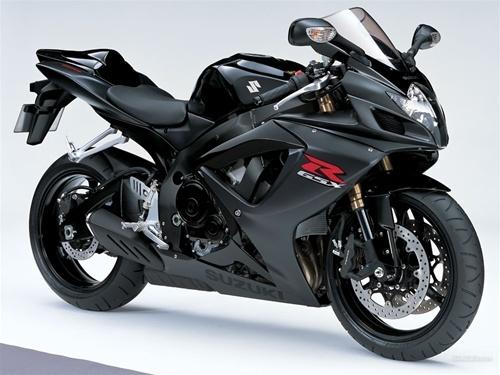 Suzuki GSXR1000 black.   Travis would LOVE this bike!
