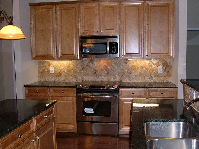 Tumbled Marble Backsplash U0026 Black Granite. Stone BacksplashKitchen ...