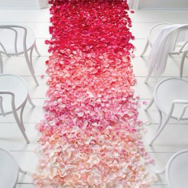 I'd love to find a way to make the flower petals out of fabric and attach this to an aisle runner. It would be much less messy and expensive that way.