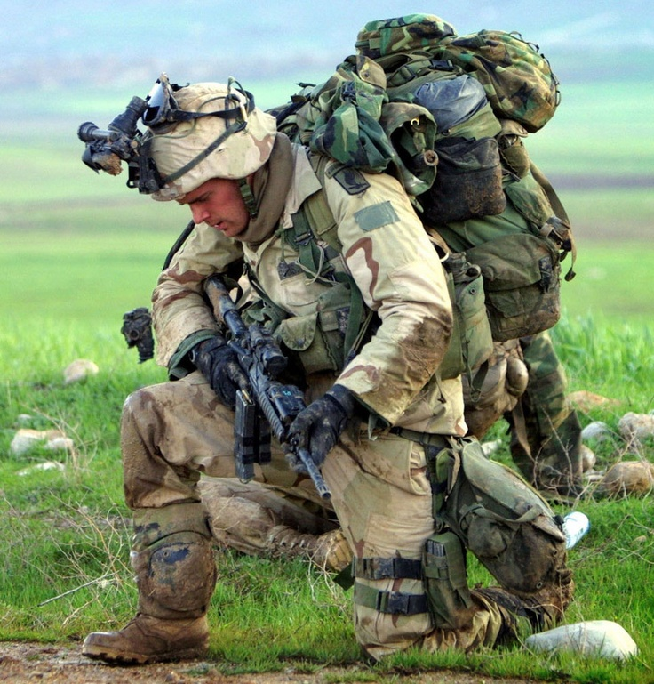 Soldier Kneeling....seeing this, makes me feel ashamed that I ever complain about anything as I am so blessed because of patriots like this brave man in a foreign land flighting for us here in the USA