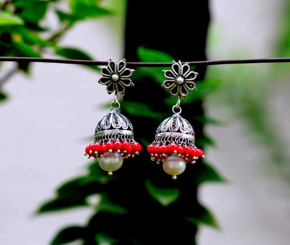 These are pair of ethnic yet very elegant, well crafted traditional hook earrings with combination of pearl and light red glass beads. Dimensions :