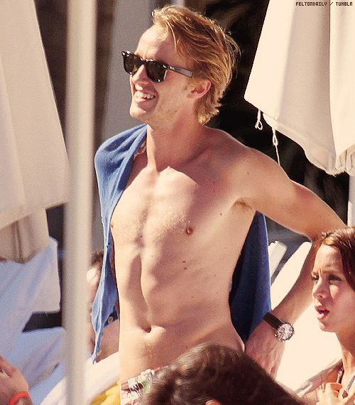 Tom Felton....or should I say Draco? Whatever you prefer to be called. Just dont put that shirt back on.
