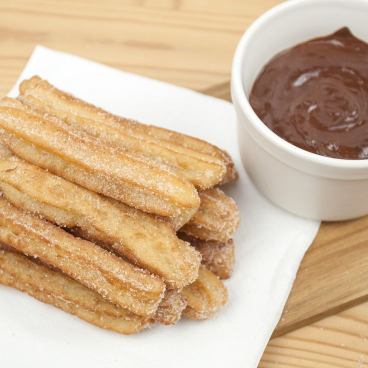 Makes 16 churros. Ingredients 1 cup water 2 tbsp vegetable oil 1 cup plain flour 3 cup cups vegetable oil for deep fat frying 1/2 tsp cinnamon 3 tbsp sugar 80g dark chocolate (suitable for vegans) 1/2 cup soya milk Zest of a medium orange You will also need: A piping bag or food bagRead more