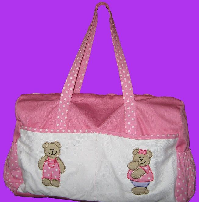 Baby bag with plain pink and white fabric and polka dot fabric for the trimmings. The applique teddy designs is from one of my design sets