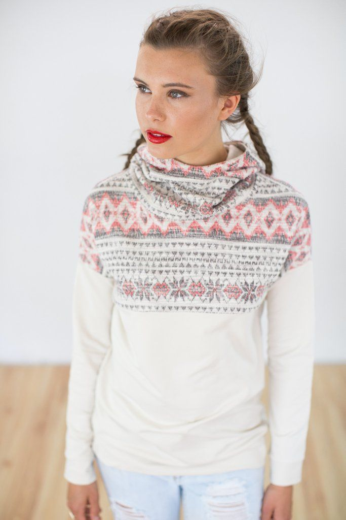 Hoodie To Go Cream Aztec.Casual and elegant hoodie crafted from a lightweight, cream colored, velvety soft sweatshirt fabric. The neckline and the outside of the hood is made of a beautiful, embroidered ethnic aztec pattern in beautiful coral red tones.