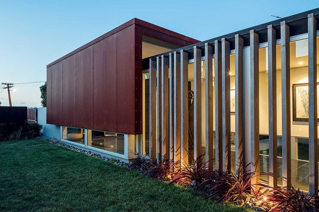Courtyard house, St heliers (NZ) by Ken Crosson. Clad in coreton steel and large vertical timber louvres.