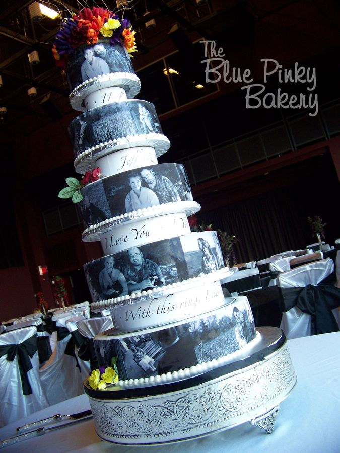 All sour cream white cake with buttercream icing. Edible images of the bride & groom. Silk flowers/topper provided by the bride. This was TALL. We were very nervous moving this into place.