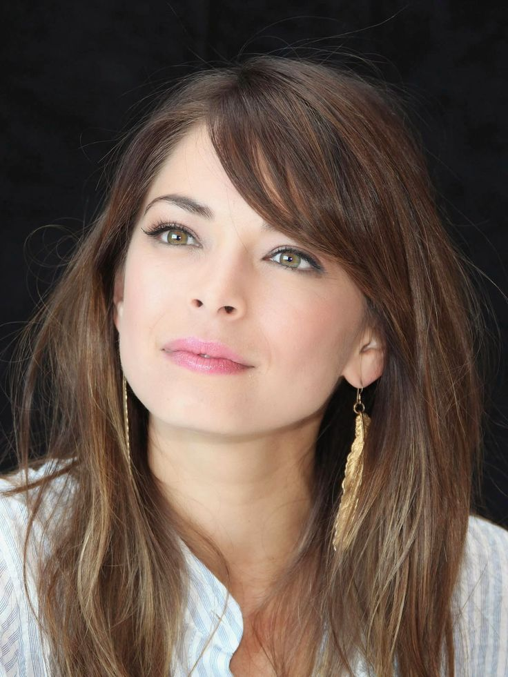 Kristin Kreuk - Smallville- I always thought she has unique looking eyes- beautiful girl.  minimal makeup-natural looking