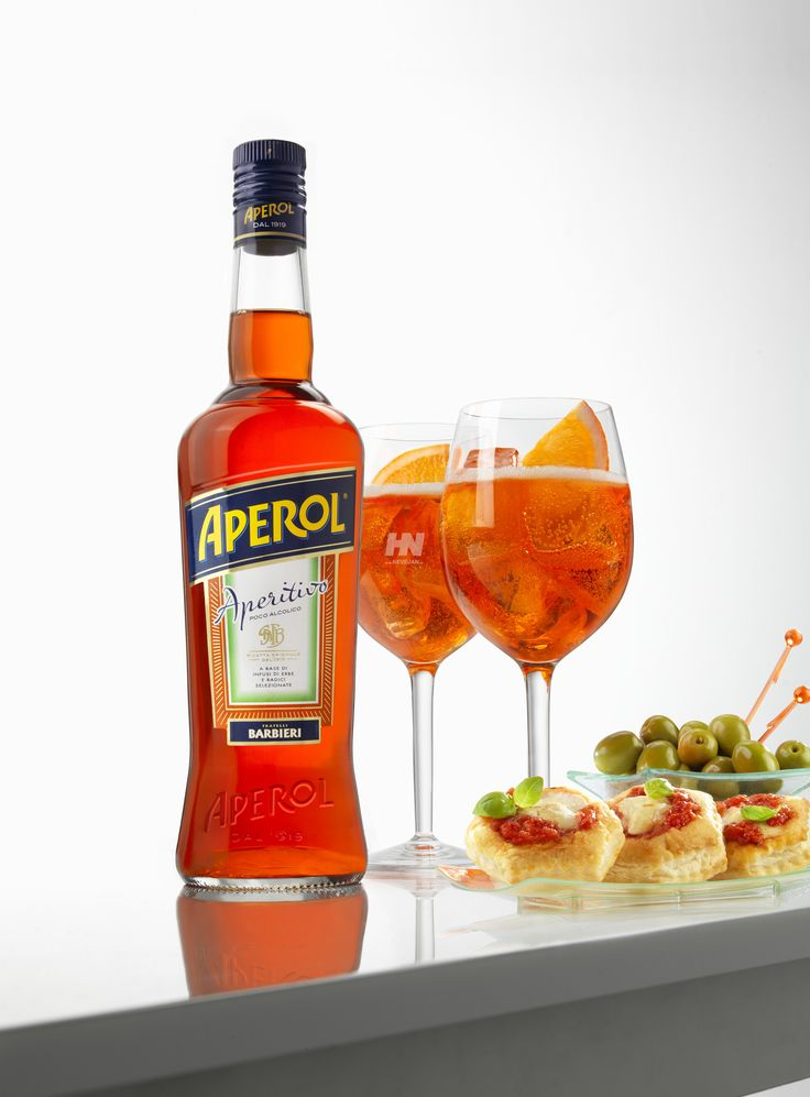 Aperol Spritz, Aperitivo ritual - The origins of this drink are not known but it is widely believed that the Spritz was born during the 19th century Austrian occupation of Italy. A true Italian tradition, an aperitivo is a pre dinner drink accompanied by small plates of food that one can easily nibble. The idea behind the aperitivo is not to satiate those pre dinner hunger pangs but to whet the appetite even more for dinner…