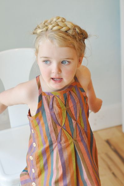 mock smocking! And this rainbow dress is adorable, although it probably won't work on a curvy grown up :(