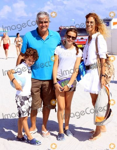 Argentine actor and ex-footballer Saul Lisazo plays soccer on the beach during the FIFA Beach Soccer Tournament that is part of the Beach Soccer Worldwide Miami Cup 2011. Saul is joined by his family, wife Monica Viedma and two children Martin, who is seen headbutting a soccer ball, and daughter Paula. Miami Beach, FL. 05/01/2011.