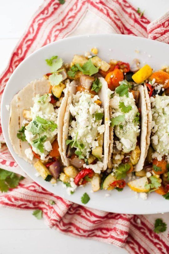 Naturally Ella: Summer Vegetarian Tacos with Avocado Cream  Take a tortilla, fill it will a ton of roasted vegetables, and slather on some avocado cream and goat cheese. It's dinner made easy.