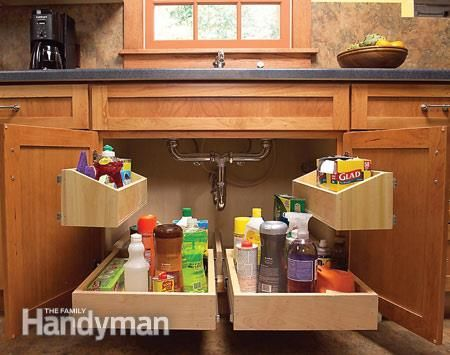 trays filled with items stored under the sink