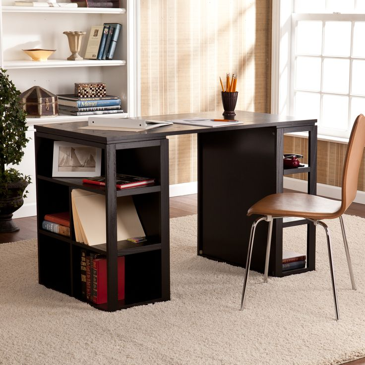 The Flexford black writing office desk features a large work surface raised on two bookcases for abundant storage and display options. The clever layout of this desk creates the perfect workspace solution for any home office, craft room, or kitchen.