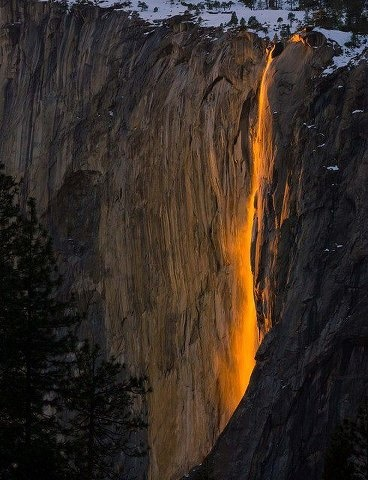 This waterfall, known as horsetail fall, flows over the sheer granite face of El Capitan in Yosemite National Park, California. Horsetail is the longest free-falling falls in the park, with a drop of 1,500 feet before it hits granite and spills another 500. At sunset in mid-February as a result of celestial configuration and cooperative winter weather, the water cascading from the high open cliff face is saturated with a golden glow, resembling fire!    Photo courtesy of Jennifer Durham
