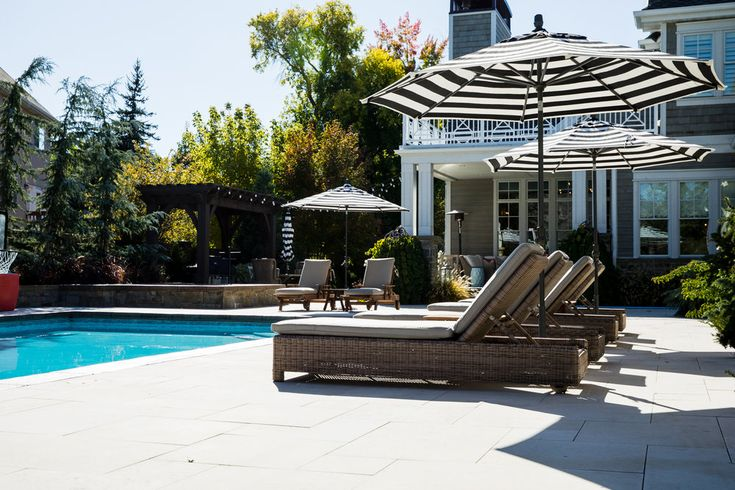 MATERIALS Pool Decking and Coping | Domestic Limestone Pavers Patio Decking | Bluestone Pavers PROJECT NOTES This limestone decking stays cool underfoot for hot summer days. All materials were selected by European Marble and Granite for freeze-thaw conditions with materials meant for l