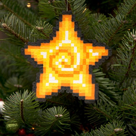 This 8-bit pixel art Christmas ornament star is handmade from Perler Beads, and makes a great tree topper!    Measuring 5.5 x 5.5, it includes an