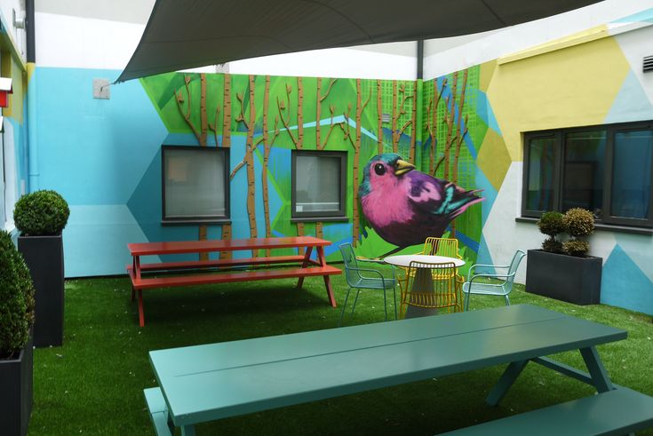 Shand House, Cardiff – transformation of communal courtyard for student accommodation. The feature murals had a funky and vibrant look, incorporating fun elements from nature including a 2m high finch.  #exteriormural #handpainted #educationmural