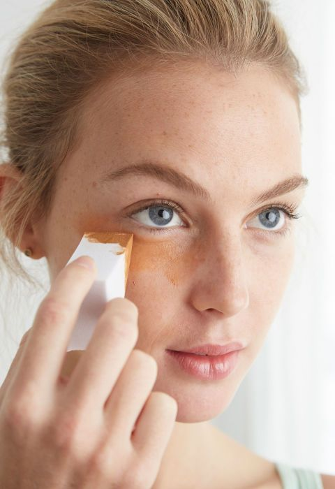 Squeeze out a nickel-size drop of tanner. If you're using a gradual tanner, apply it with your fingers; for a regular formula, put it on with a makeup sponge so you don't stain your hand. Lightly spread the color all over, going to your hairline, up to your bottom lashes, along your jaw, and down your neck.