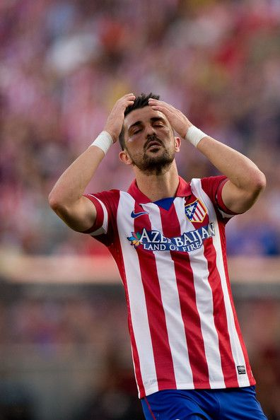 David Villa of Atletico de Madrid reacts as he fail to score during the La Liga match between Club Atletico de Madrid and Malaga CF at Vicen...