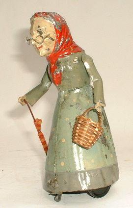 winkel von sinkel ...antique tin toy....Old Lady with basket and umbrella.