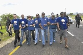 DA delegation march towards President Zuma's house. The opposition party has requested details of the alleged R248-million upgrade to the private residence. | Photo: www.sowetanlive.co.za / Reuters