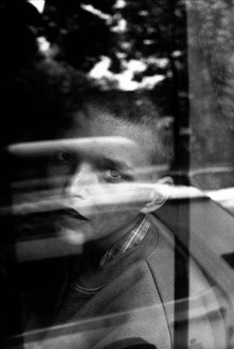 Paolo Pellegrin. ROMANIA. Bucharest. Homeless child on a police car. 1997