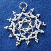 Little Netted Snowflake by JO-ANN WOOLVERTON ///// PS: I've made it and it's gorgeous!