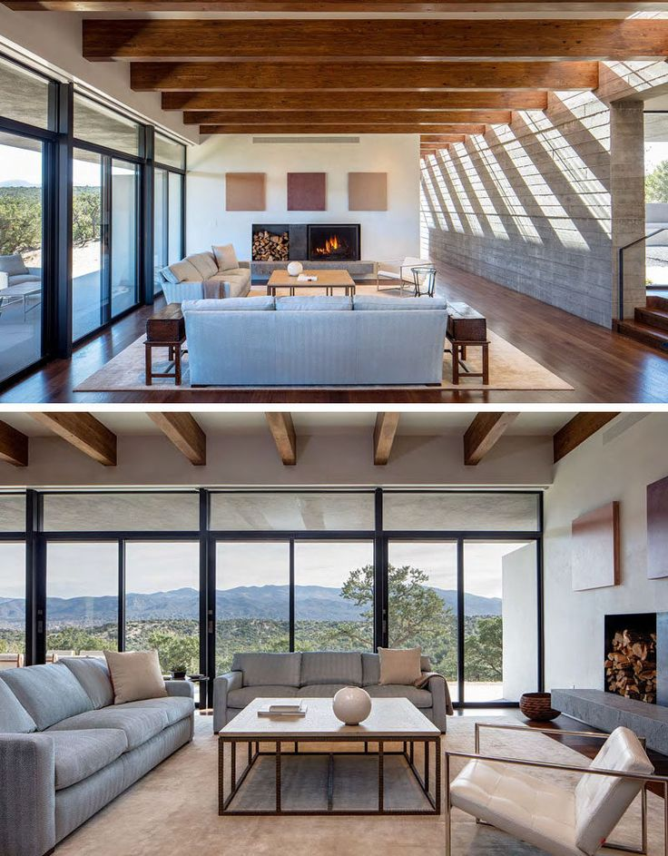 This modern living room is focused on the fireplace and has sliding glass doors that open up to the shaded porch outside.