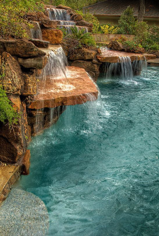I would want the stones to be right above the water about 3 inches, make a sort of waterfall path around the pool. So refreshing.