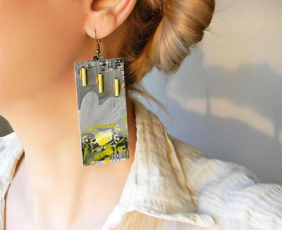 Unique abstract paper earrings with modern minimalist hand