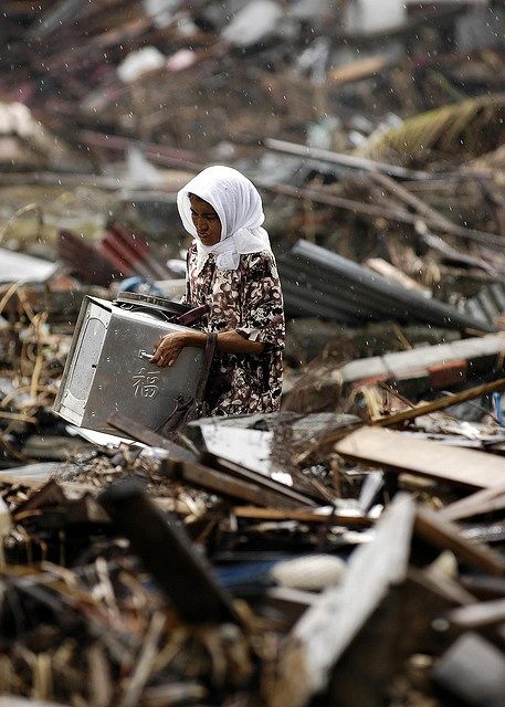 Woman searches through debris where her house once stood, Banda Aceh, Sumatra, Indonesia by simminch, via Flickr