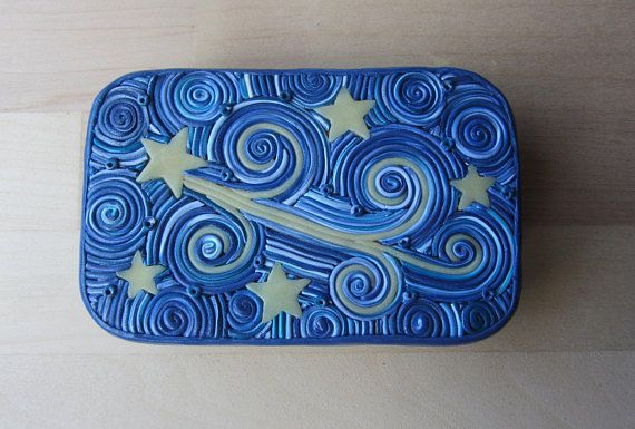 This is a shooting star design on an upcycled Altoids mint tin i.e. 3.5 x 2.75 x 0.75. I glaze the polymer with semigloss to bring out the beautiful colors and improve the durability. Created with a mix of blues, whites and glow in the dark polymer clay. My tins are my own unique