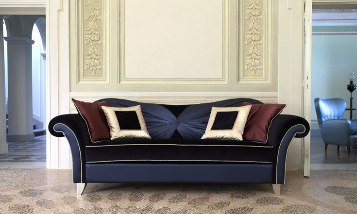 Liviane sofa, in blue velvet and blue satin, enriched by a particular tailoring work: a knot that elegantly drapes the back. Light adds the finishing touch enhancing the contrast between the mat soft velvet and the brilliant satin. Simple lines and impressive look.
