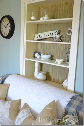 Beach-Mat Lined Bookcase - we used this idea for our bookshelves