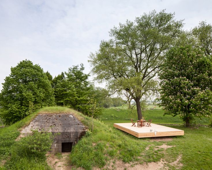 Architects from B-ILD decided to transform the bunker that was used in World War II into a functional holiday house!