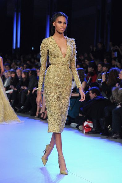A model walks the runway during the Elie Saab show as part of Paris Fashion Week Haute Couture Spring/Summer 2014 on January 22, 2014 in Par...