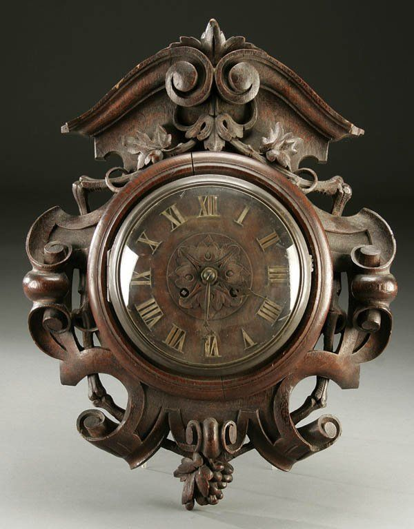 A good swiss quot black forest carved oak wall clock