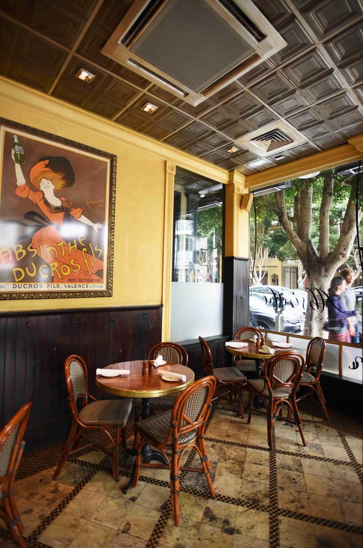 Warm walls and turn-of-the-century lithograph prints adorn the walls of the Brasserie