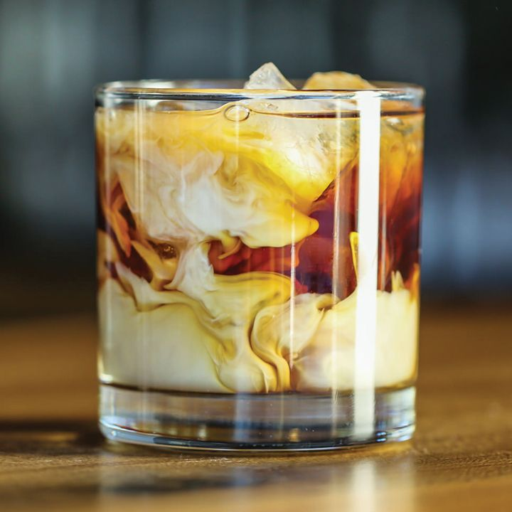 White Russian - Add to ice filled glass: 2 oz Vodka, 1 oz Kahlua, 1 oz+ light or heavy cream. Stir.