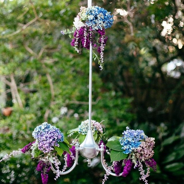 Check out our sweet floral chandelier- we have 2 plain silver chandeliers that can be uniquely decorated for your event using your choice of flowers and decorations.  Contact Sue and Tessa for pricing, availability and design requirements.  #floralchandeliers #flowers #sweet #weddings #parties #eventdecor #styling #willowandvine