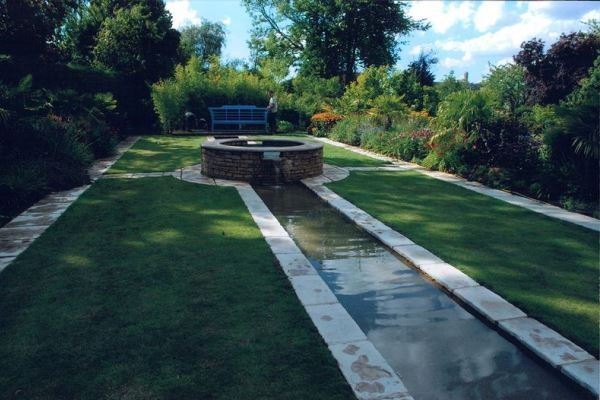 The client wanted his Grandchildren to be able to splash and run in the Rill, so we lined the Rill<br>and spread non-slip resin bonded gravel in the base of it! As with all of our features no liner is left<br>visible to spoil the effect.