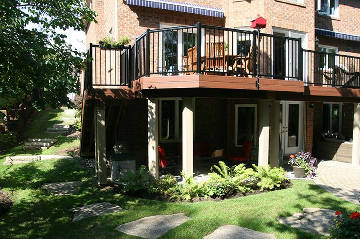 A 2nd level custom Armadillo composite deck with aluminum railing built by Hickory Dickory Decks in Oakville.