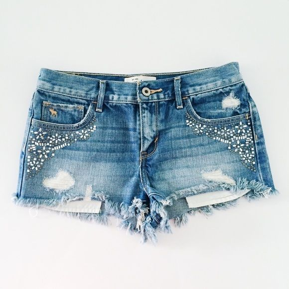 HOST PICK! Abercrombie - Embellished Shorts Abercrombie & Fitch embellished distressed denim short shorts. Super cute floral embellishment. Excellent condition. Only worn once. Actually Abercrombie Kids size 16, but fits just like Abercrombie women's size 0.  Offers welcome.  No trades.  Bundle for discount. Abercrombie & Fitch Shorts Jean Shorts