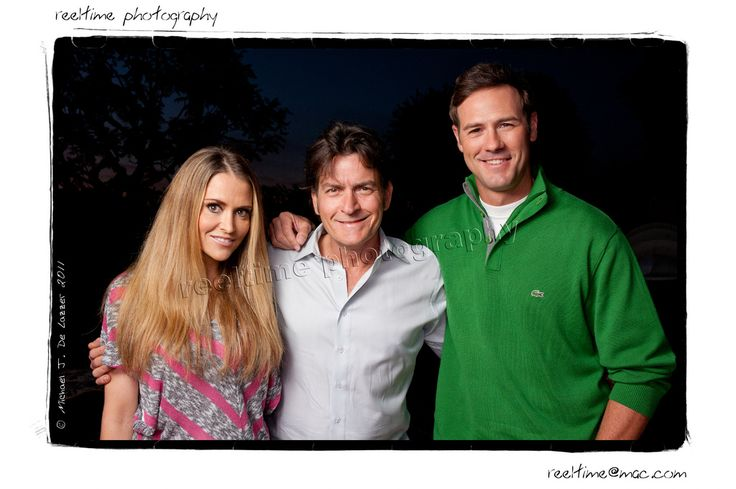 https://flic.kr/p/aEwtsA | Charlie, Brooke, & Chris. | Charlie Sheen, ex-wife Brooke Mueller, and Chris Jacobs in Charlie's backyard.  1 SB-900 up and left, 1 foot behind a Lastolite Tri-Grip transparent.  Tried to save as much sunset as I could, but I needed to close down to hold focus on 3 subjects.  Probably closed down too much, but it works.