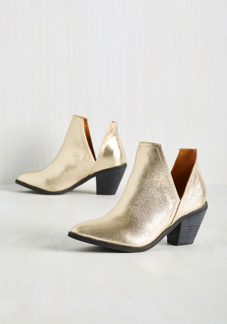 Wishing You the Very Zest Bootie in Gold. With these metallic gold booties in your footwear collection, sartorial success is a guarantee! #gold #modcloth